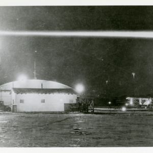 Air Mail plane on field at nighttime, 1925