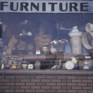 Dicker's Furniture Antiques Window Closeup, 301 S Dubuque St, 1975