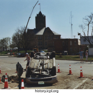View of Johnson County Courthouse and overturned car