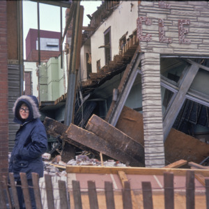 Person in Front of Debris, 200-Block East College Street, 1970-1976