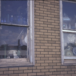 Dicker's Furniture Windows, 301 S Dubuque St, 1975