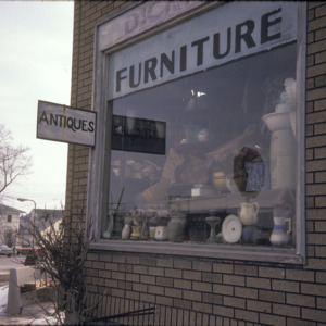 Dicker's Furniture Window Closeup, 301 S Dubuque St, 1975